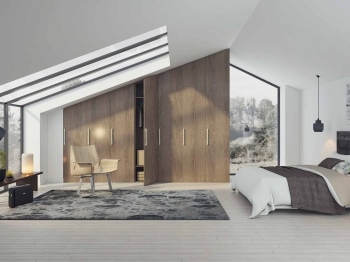 https://www.inspiredelements.co.uk/wp-content/uploads/2020/04/loft-angled-fitted-wardrobe-H1379-700x524.jpg