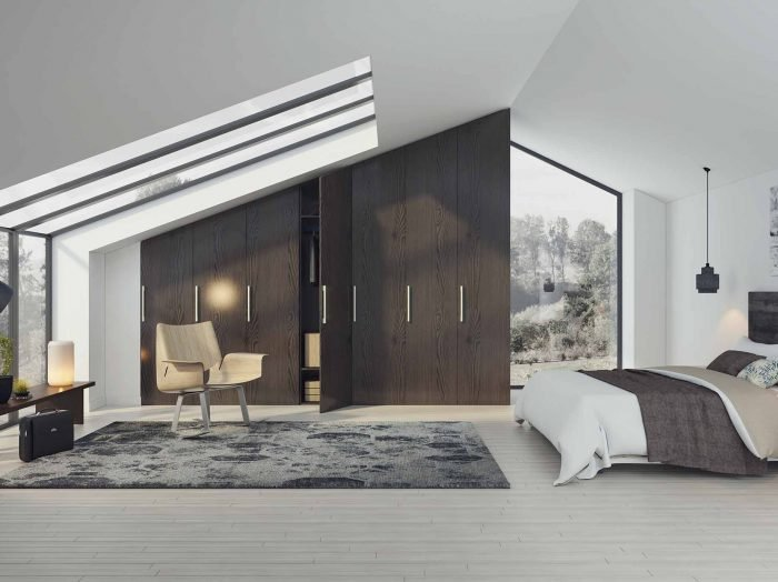https://www.inspiredelements.co.uk/wp-content/uploads/2020/04/loft-angled-fitted-wardrobe-H3406-700x524.jpg