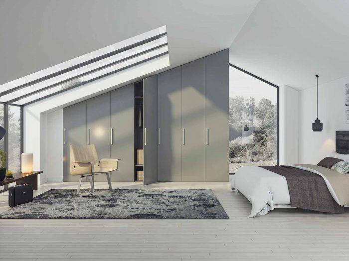 https://www.inspiredelements.co.uk/wp-content/uploads/2020/04/loft-angled-fitted-wardrobe-U732-700x524.jpg