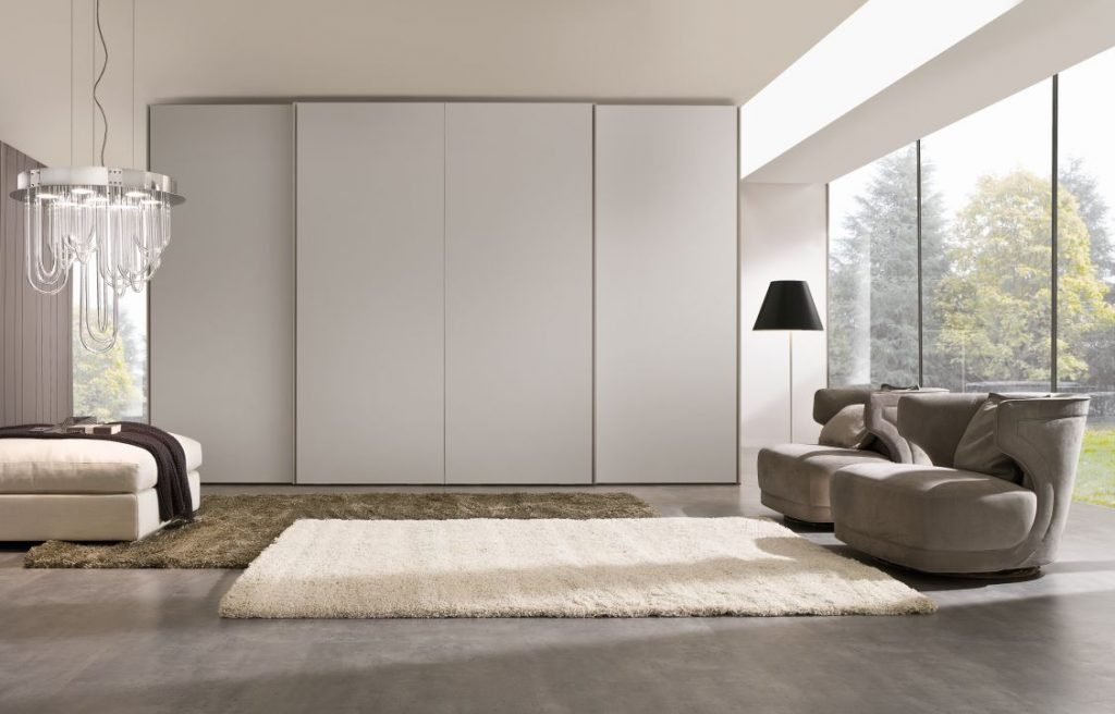 Sliding wardrobes with 4 doors in white matt frameless top hung