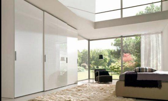 Sliding door fitted wardrobes, frameless top hung in white gloss and matt