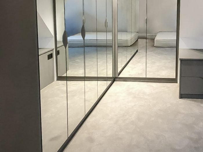 https://www.inspiredelements.co.uk/wp-content/uploads/2020/05/25-L-shape-hinged-mirror-wardrobe0-700x524.jpg