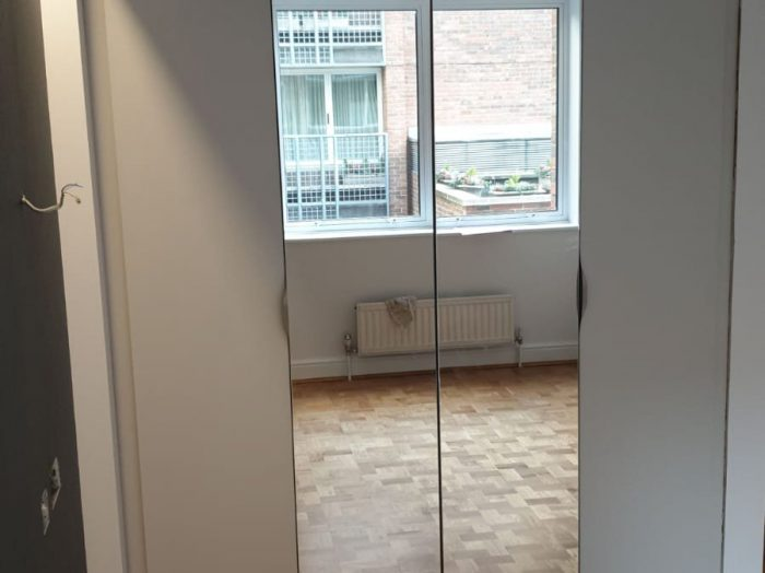 https://www.inspiredelements.co.uk/wp-content/uploads/2020/05/Hinged-wardrobe-with-grey-mirror-700x524.jpg