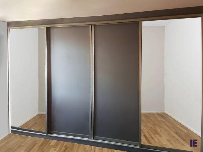 https://www.inspiredelements.co.uk/wp-content/uploads/2020/05/jay-bronze-fa47-grey-sliding-doors-700x524.jpg