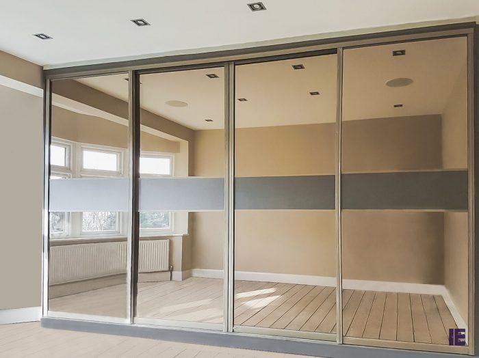 https://www.inspiredelements.co.uk/wp-content/uploads/2020/05/jay-bronze-mirror-sliding-door-2-700x524.jpg