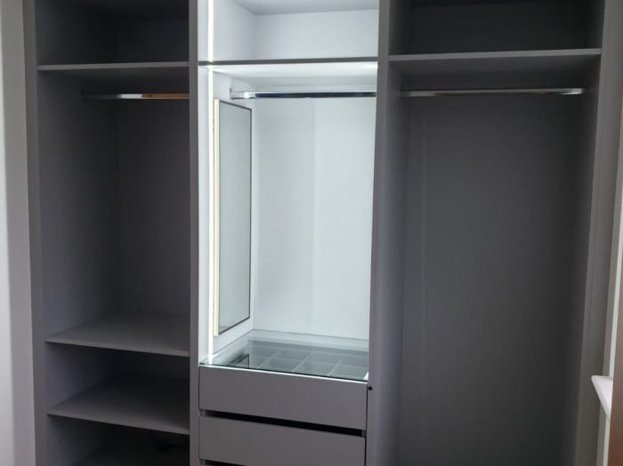 https://www.inspiredelements.co.uk/wp-content/uploads/2020/05/open-carcass-wardrobe-with-glass-divider-700x524.jpg