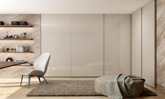 Bespoke fitted frameless sliding door wardrobe in L shape with Light Grey finish