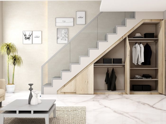 https://www.inspiredelements.co.uk/wp-content/uploads/2021/04/Fitted-Folding-door-wardrobe-under-staircase-area-2-700x524.jpg