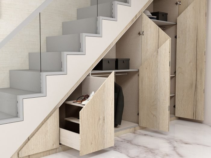 https://www.inspiredelements.co.uk/wp-content/uploads/2021/04/Fitted-Folding-door-wardrobe-under-staircase-area-4-1-700x524.jpg