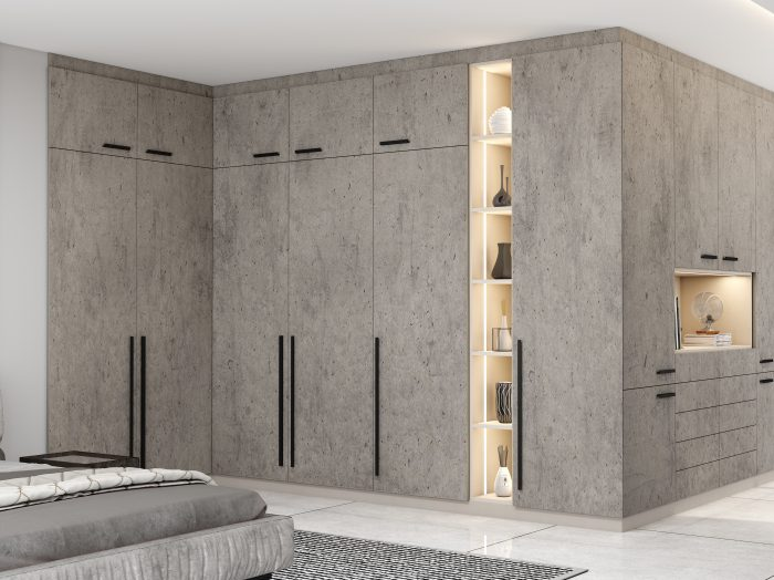 https://www.inspiredelements.co.uk/wp-content/uploads/2021/04/Fitted-Hinged-Corner-Wardrobes-in-concrete-finish-2-700x524.jpg