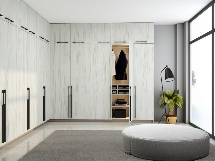 https://www.inspiredelements.co.uk/wp-content/uploads/2021/04/Fitted-Hinged-Corner-Wardrobes-in-white-woodgrain-finish-2-700x524.jpg