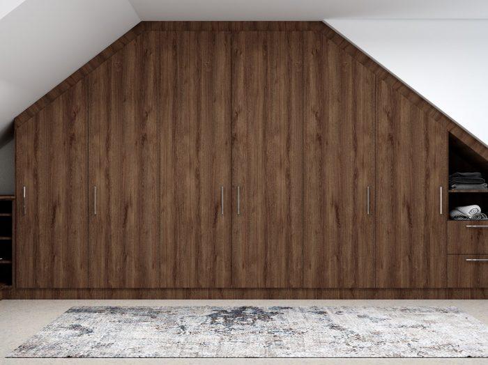 https://www.inspiredelements.co.uk/wp-content/uploads/2021/04/Fitted-Loft-Storage-wardrobe-dark-walnut-and-white-finish-1-700x524.jpg