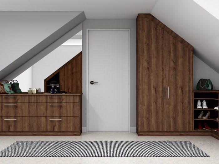https://www.inspiredelements.co.uk/wp-content/uploads/2021/04/Fitted-Loft-Storage-wardrobe-dark-walnut-and-white-finish_2-1-700x524.jpg