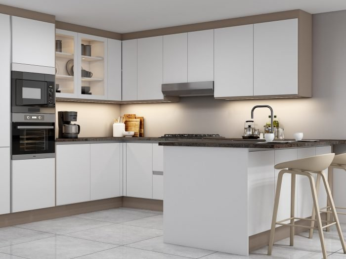 https://www.inspiredelements.co.uk/wp-content/uploads/2021/04/G-shape-Handleless-Kitchen-in-White-matt-Pebble-finish-with-black-handle-profile_1-1-700x524.jpg