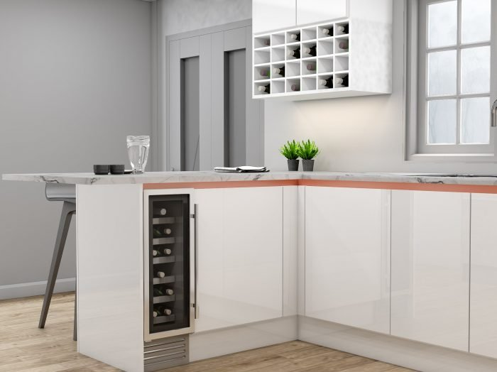 https://www.inspiredelements.co.uk/wp-content/uploads/2021/04/Handleless-g-shape-Kitchen-in-Brass-handle-profile-with-high-gloss-white-and-concrete-finish_Wine-rack_2-1-700x524.jpg