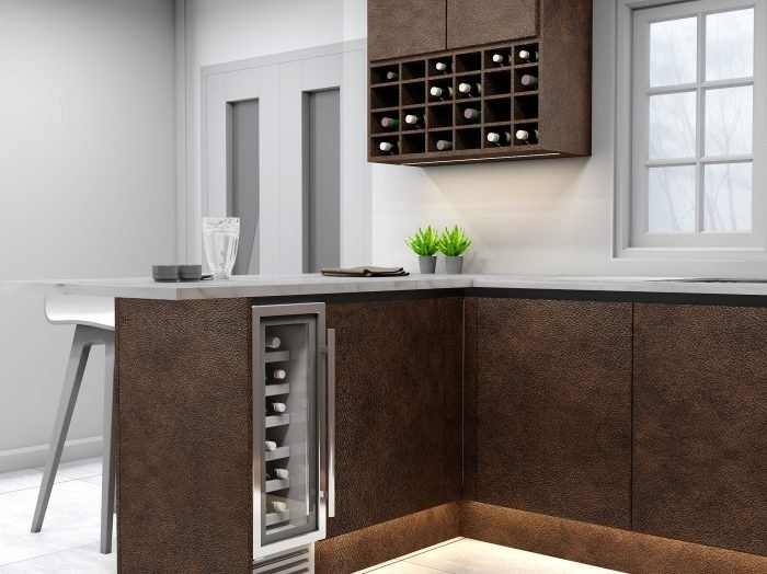 https://www.inspiredelements.co.uk/wp-content/uploads/2021/04/Handleless-g-shape-Kitchen-in-black-handle-profile-with-Maya-bronze-textured-finish-finish_Wine-rack-1-700x524.jpg
