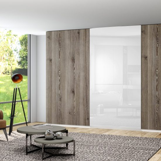 Made to measure top hung frame less sliding wardrobe in dark woodgrain walnut finish with full silver mirror door