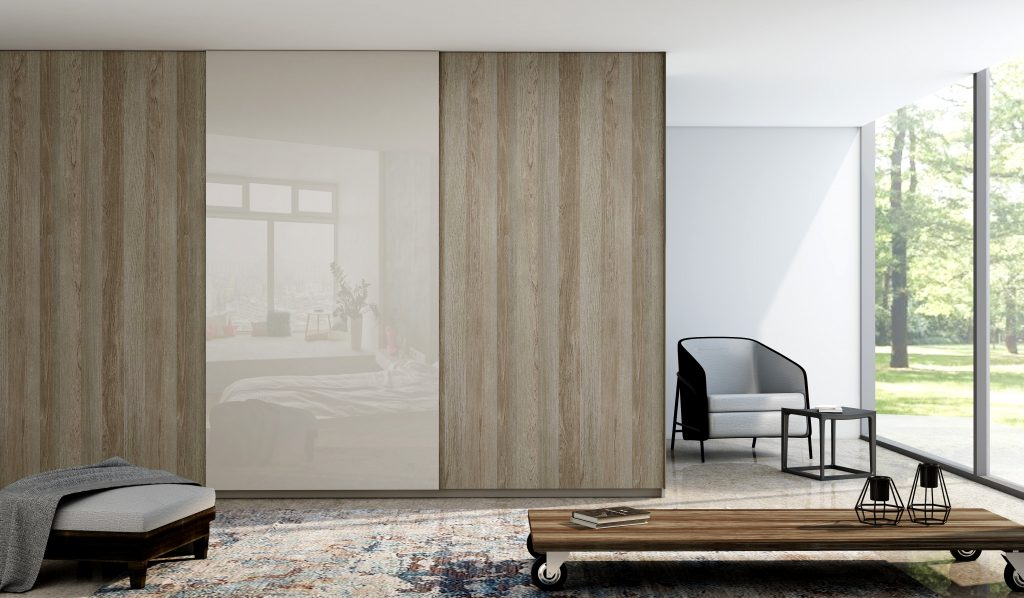 Top hung frameless sliding wardrobe in woodgrain walnut finish with full cashmere gloss door