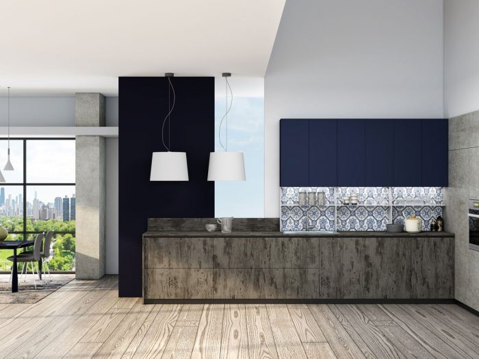 https://www.inspiredelements.co.uk/wp-content/uploads/2021/04/Premiumline-kitchen-with-black-handleless-profile-in-Syncrone-Ice-textured-beton-and-Indigo-blue-matt-finish-2-700x524.jpg