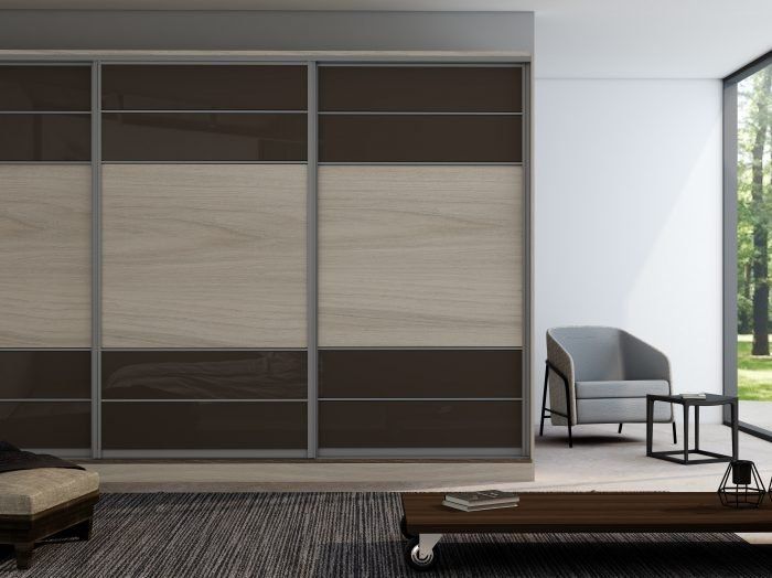 https://www.inspiredelements.co.uk/wp-content/uploads/2021/04/Sliding-Fitted-Wardrobe-with-five-panels-in-combination-of-Brown-gloss-and-Oak-Grain.-1-700x524.jpg