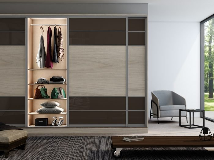 https://www.inspiredelements.co.uk/wp-content/uploads/2021/04/Sliding-Fitted-Wardrobe-with-five-panels-in-combination-of-Brown-gloss-and-Oak-Grain.-700x524.jpg