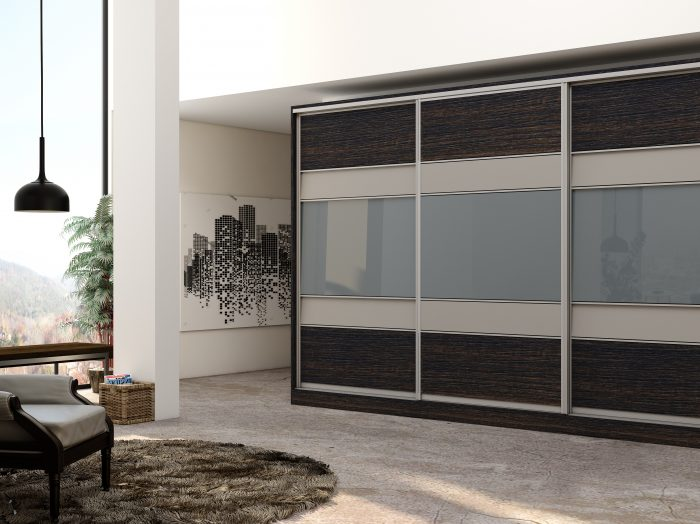 https://www.inspiredelements.co.uk/wp-content/uploads/2021/04/Wooden-sliding-Fitted-Wardrobe-with-five-panels-in-combination-of-Dark-woodgrain-Snow-White-and-light-Grey-Gloss-finish-1-700x524.jpg