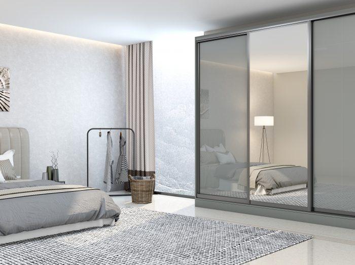 https://www.inspiredelements.co.uk/wp-content/uploads/2021/05/Bespoke-wooden-sliding-wardrobe-in-dust-grey-gloss-finish-with-full-silver-Mirror-1-700x524.jpg