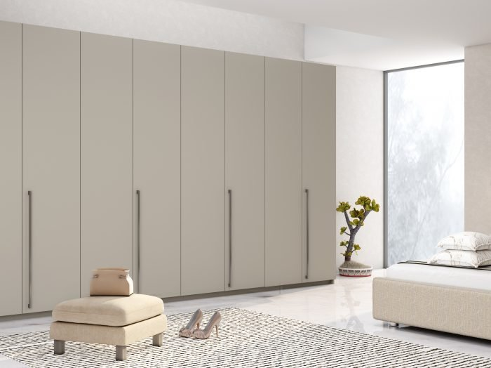 https://www.inspiredelements.co.uk/wp-content/uploads/2021/05/Bi-fold-folding-door-wardrobe-in-esperia-light-grey-1-700x524.jpg