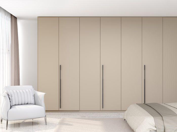 https://www.inspiredelements.co.uk/wp-content/uploads/2021/05/Bi-fold-folding-door-wardrobe-in-stone-grey-1-700x524.jpg