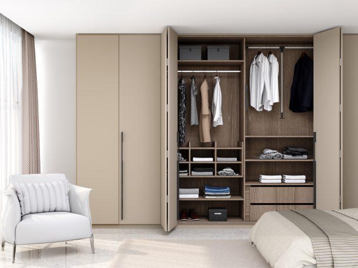 https://www.inspiredelements.co.uk/wp-content/uploads/2021/05/Bi-fold-folding-door-wardrobe-in-stone-grey-700x524.jpg