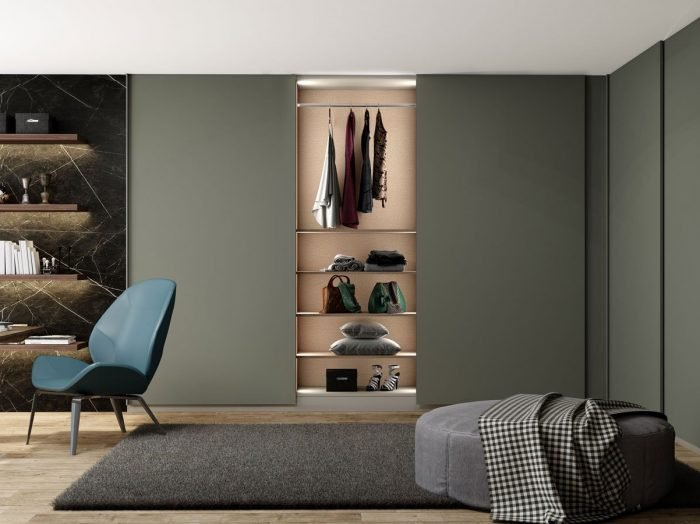 https://www.inspiredelements.co.uk/wp-content/uploads/2021/05/Made-to-measure-top-hung-frame-less-L-Shape-sliding-wardrobe-in-Grey-Finish-1-700x524.jpg