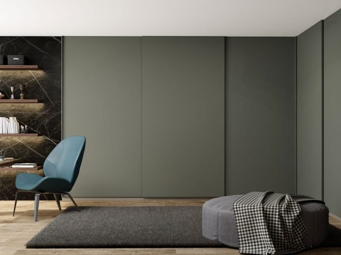https://www.inspiredelements.co.uk/wp-content/uploads/2021/05/Made-to-measure-top-hung-frame-less-L-Shape-sliding-wardrobe-in-Grey-Finish-700x524.jpg