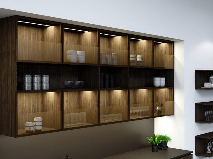https://www.inspiredelements.co.uk/wp-content/uploads/2021/05/Premiumline-kitchen-with-black-handleless-profile-in-Bronze-oak-woodgrain-and-khaki-grey-matt-finish-1-700x524.jpg