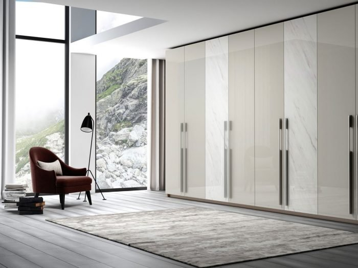 https://www.inspiredelements.co.uk/wp-content/uploads/2021/06/Fitted-Hinged-wardrobe-with-long-handle-in-light-grey-gloss-and-white-gloss-levanto-stone-finish-1-700x524.jpg