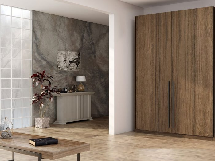 https://www.inspiredelements.co.uk/wp-content/uploads/2021/06/Fitted-wardrobe-with-pocket-door-system-in-walnut-wood-finish-700x524.jpg