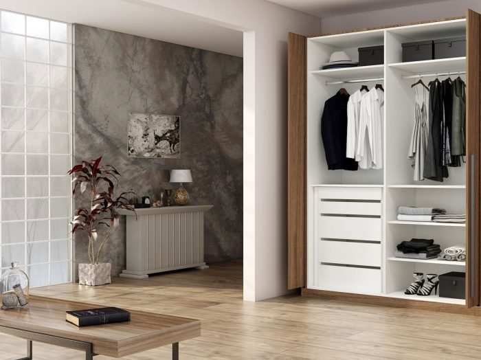 https://www.inspiredelements.co.uk/wp-content/uploads/2021/06/Fitted-wardrobe-with-pocket-door-system-in-walnut-wood-finish_1-1-700x524.jpg