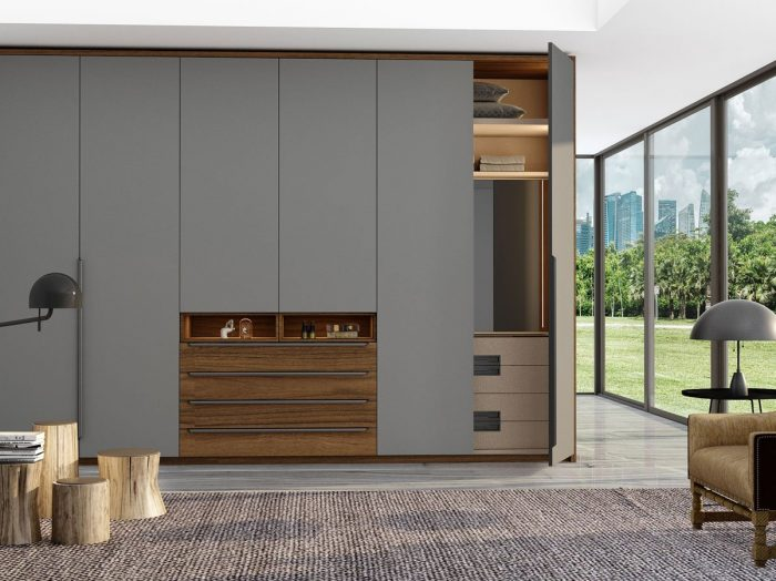 https://www.inspiredelements.co.uk/wp-content/uploads/2021/06/HInged-Fitted-wardrobe-with-chest-drawers-in-perfect-matt-dust-grey-and-antique-brown-woodgrain-finish-4-700x524.jpg