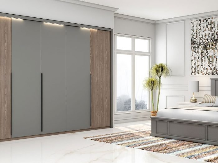 https://www.inspiredelements.co.uk/wp-content/uploads/2021/06/Hinged-Fitted-Wardrobe-in-combination-of-perfect-matt-dust-grey-and-tivoli-woodgrain-finish-1-1-700x524.jpg