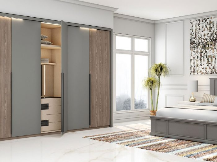 https://www.inspiredelements.co.uk/wp-content/uploads/2021/06/Hinged-Fitted-Wardrobe-in-combination-of-perfect-matt-dust-grey-and-tivoli-woodgrain-finish-2-700x524.jpg