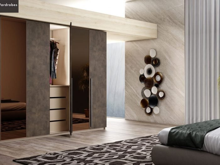 https://www.inspiredelements.co.uk/wp-content/uploads/2021/06/Hinged-Fitted-Wardrobe-with-full-bronze-mirror-in-Maya-Bronze-finish-2-1-700x524.jpg