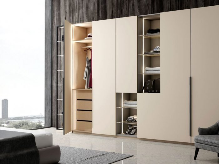 https://www.inspiredelements.co.uk/wp-content/uploads/2021/06/Hinged-Fitted-wardrobe-with-open-shelves-in-cashmere-grey-and-silver-grey-finish-1-1-1-700x524.jpg