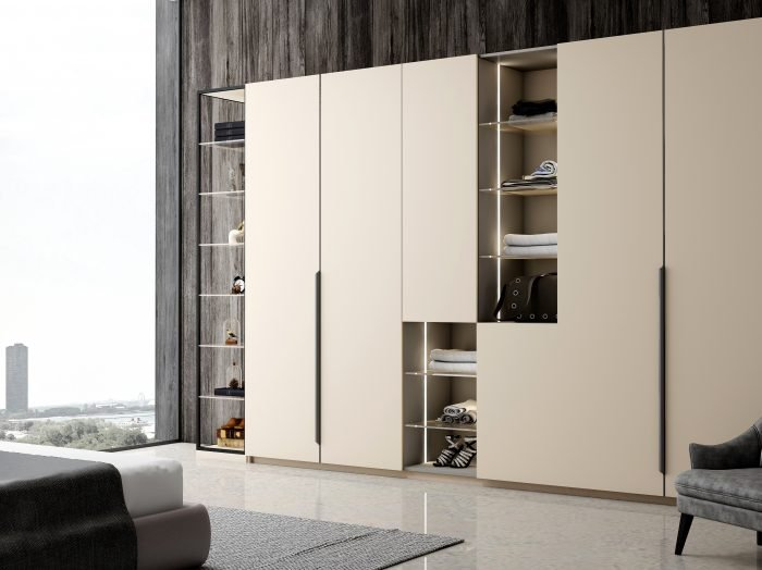 https://www.inspiredelements.co.uk/wp-content/uploads/2021/06/Hinged-Fitted-wardrobe-with-open-shelves-in-cashmere-grey-and-silver-grey-finish-1-1-700x524.jpg