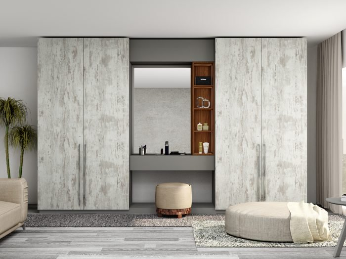 https://www.inspiredelements.co.uk/wp-content/uploads/2021/06/Hinged-Wardrobe-with-Dresser-Unit-Storage-in-combination-of-Cleaf-Matrix-Dust-Grey-and-Lincoln-Walnut--700x524.jpg