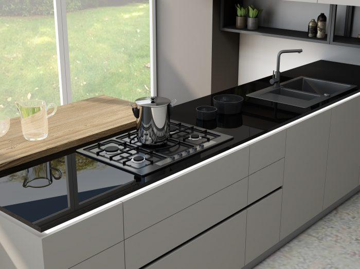 https://www.inspiredelements.co.uk/wp-content/uploads/2021/06/Kitchen-worktop-glass-black-1-700x524.jpg