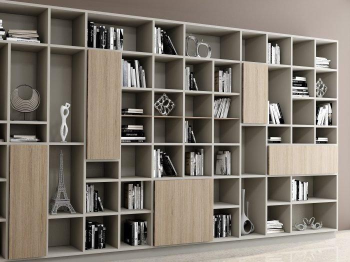 https://www.inspiredelements.co.uk/wp-content/uploads/2021/06/Living-room-bespoke-shelving-in-woodgrain-finish-2-1-700x524.jpg