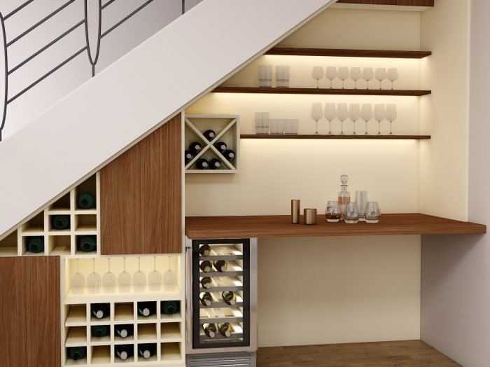 https://www.inspiredelements.co.uk/wp-content/uploads/2021/06/Understairs-Fitted-Bar-area-in-Lincoln-walnut-and-cream-Finish-with-1-700x524.jpg